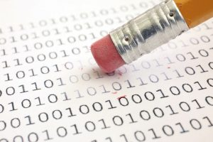 A pencil eraser being used to erase binary data